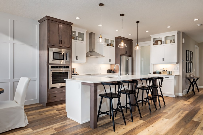 Broadview Homes kitchen photo with island, stools and cabinets